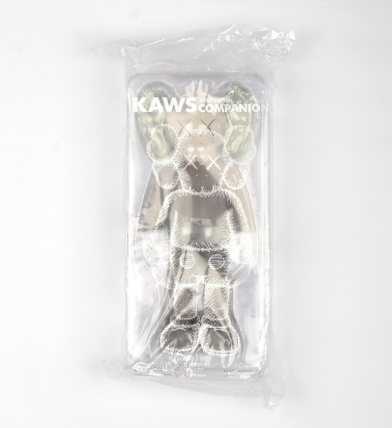 "Entitled ""Companion (Brown)"", this art toys by Kaws is an open edition. Made in 2016, format is 10,6 x 4,3 inches (27 x 11 cm). The work is sold in its original box."