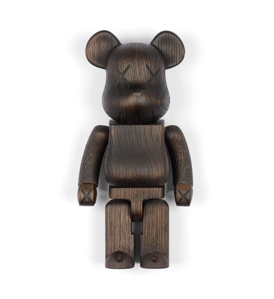 "Entitled ""400% Bearbrick"", this wooden sculpture is the collaboration between the brand of Kaws : Original Fake and Nexus 7. Made in 2007 by the Japanese brand Karimoku, it's an edition of 400. Format : 11 inches (28 cm). The sculpture is sold in its original box."